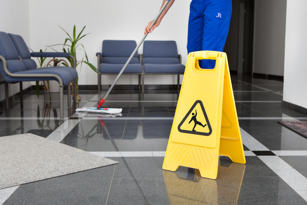 Office Cleaning london Sheffield Rotherham doncaster barnsley south yorkshire wet floor with slip warning sign