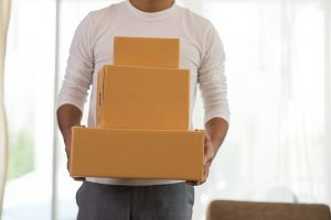 Man carrying three boxes - JR cleaning and removals - Sheffield, Rotherham and rest of South Yorkshire