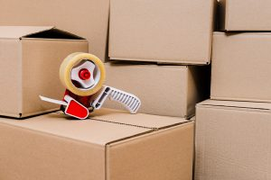Packing tape dispenser and boxes - 7 Reasons to hire a moving company - JR cleaning and removals - Sheffield, Rotherham and rest of South Yorkshire